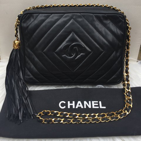 3f9df184c85f @oyeinvic. 2 years ago. Orpington, United Kingdom. CHANEL Vintage Chevron  Camera Bag With Tassel ...