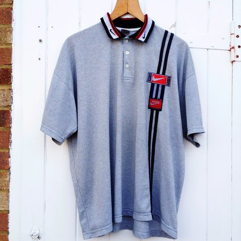 23bf27e2 @pacifye. 3 years ago. United Kingdom. STUNNING VINTAGE NIKE GREY POLO IN  MENS MEDIUM! Lovely oversized fitting 90s Grey Nike polo shirt with black  white ...