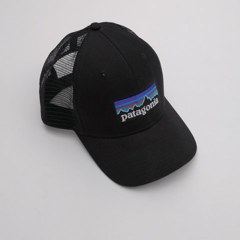 0b4dfb64f3fd0 VINTAGE BLACK PATAGONIA TRUCKER CAP WITH WHITE SPELLOUT LOGO - Depop