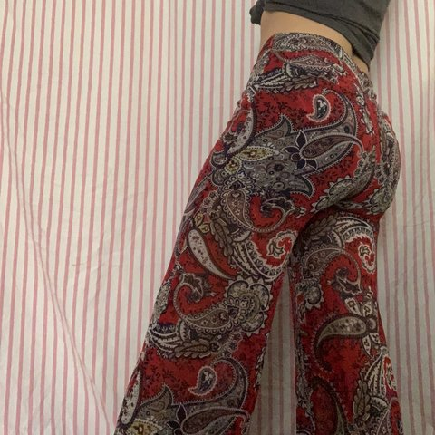 4903c3696e944 @sisily. in 20 hours. Fayetteville, United States. Red paisley print flare  pants.
