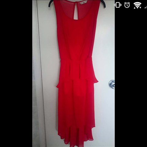 67a9e6eec15 Red dipped hem playsuit from Miss Selfridge. Dipped and hem. - Depop
