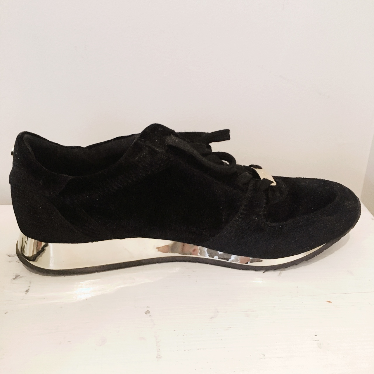carvela black and gold trainers