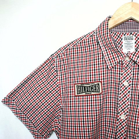17660737a @caseclothing. 7 months ago. Manchester, United Kingdom. Vintage Tommy  Hilfiger Spell Out Short Sleeve Checked Shirt. Mens Size large.