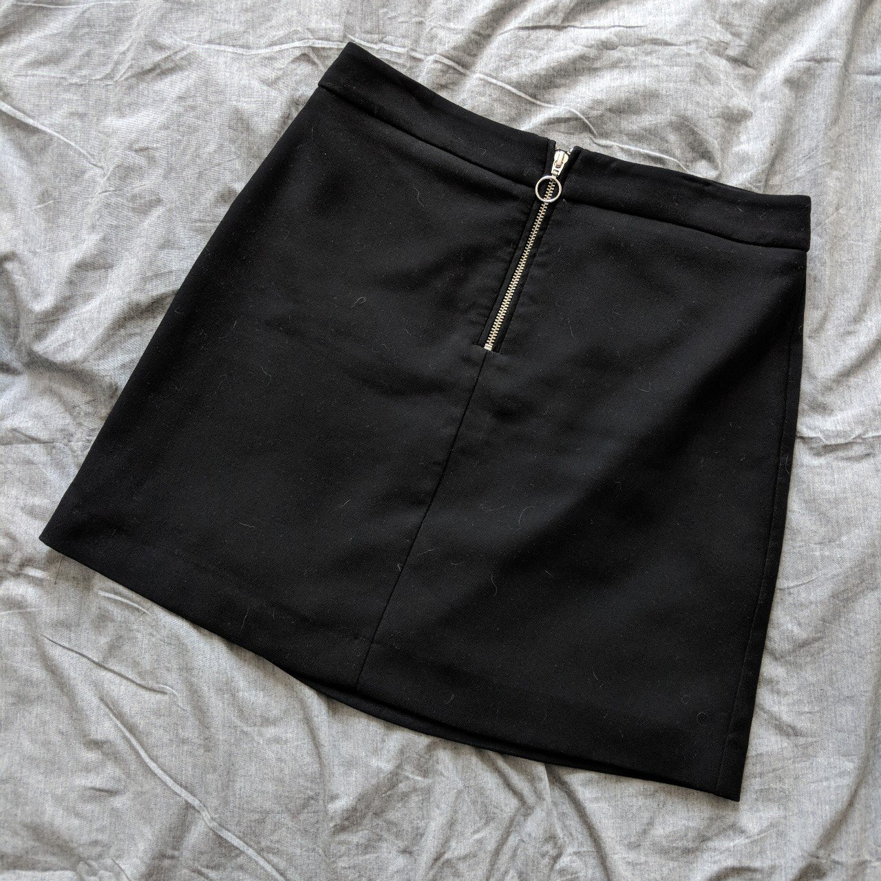 8e84052619d8 Black Mango mini skirt with front zip and O-ring detail. 28