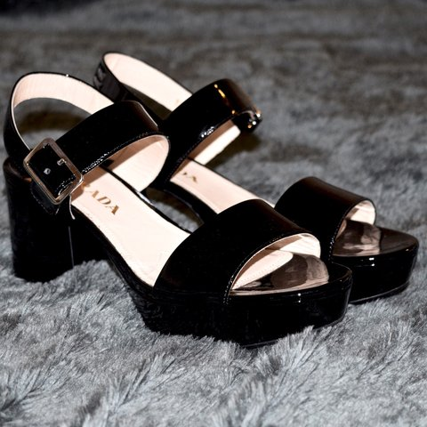 d4fe1d339e @arlevine. 3 years ago. Phoenix, AZ, USA. Prada black patent leather block  heel sandal size 37 1/2.