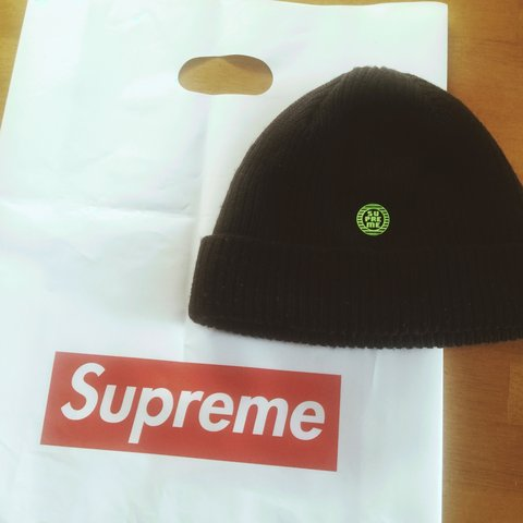 Supreme navy beanie with neon green logo. 9 10 condition PM - Depop 50f8d58215b