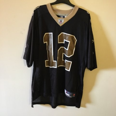 c428c2c6e83 @garmtrees. 2 years ago. Falmer, United Kingdom. Reebok New Orleans Saints  Jersey. #12 Marques Colston. Black ...