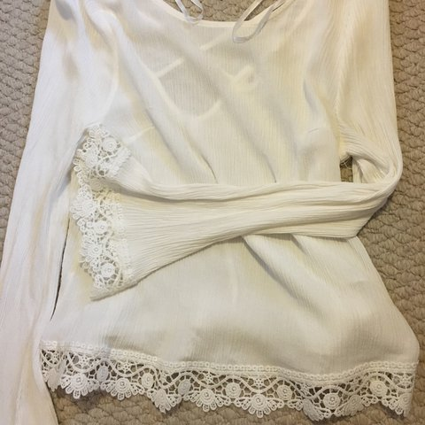 42248679acfbe1 @bellelingerieco. 2 years ago. Bradford, UK. H&M coachella collection white  long sleeve top.