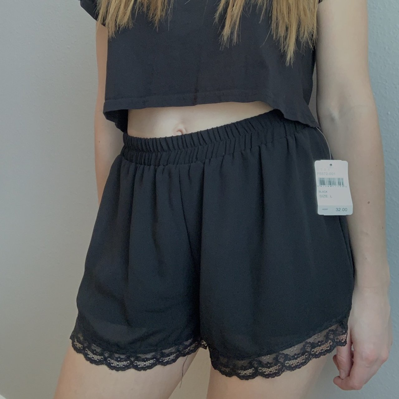 7294c6462b Cute black shorts with a lace trim, the tag says large but i - Depop