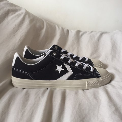 6bce58f1a5 Black low top Converse Chuck Taylor shoes with the signature - Depop
