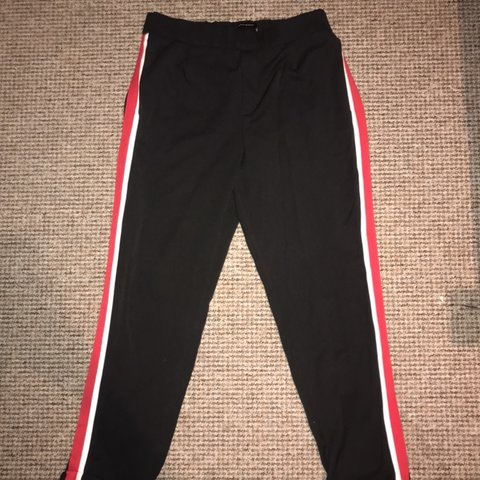 2ddf7300 @hattiexquigley. 3 days ago. Liverpool, United Kingdom. ZARA black trousers  with red and white stripe ...