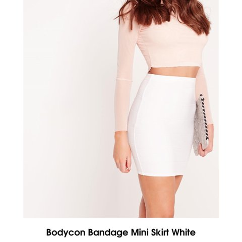 11215cced Selling missguided white bodycon bandage mini skirt, size 6. - Depop