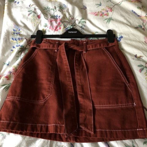 bbcdb485 Topshop rust belted utility skirt. Amazing on and so comfy, - Depop
