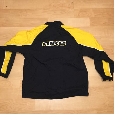 bf6b24336c57 Late 90s Nike Windbreaker Staple black and yellow colors Tag - Depop