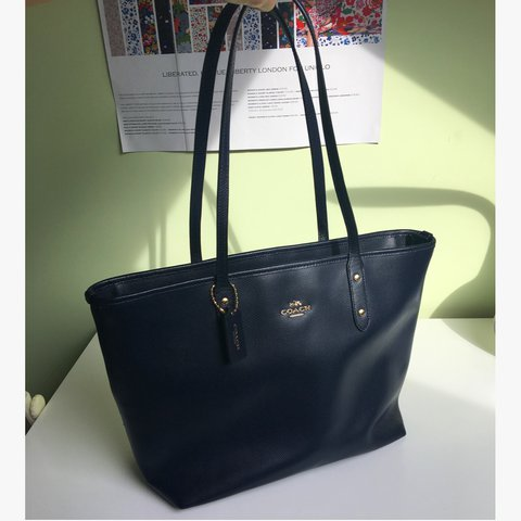 7816a933940 @k3ying. last year. London, United Kingdom. Navy Coach leather City Zip Tote  bag ...