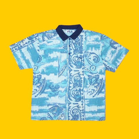 2a84ea44 @thetowndrow. 11 months ago. Leeds, United Kingdom. Vintage 80s / 90s FILA  short sleeve polo shirt. Textured cotton construction. Abstract all over  print.