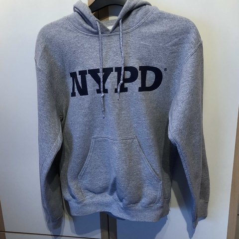 "0141864a5 @tegs_xox. 3 months ago. Sheffield, United Kingdom. **AMAZING QUALITY ""NYPD""  TOPSHOP GREY HOODIE"