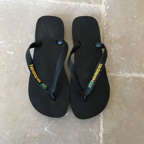 afef7a184 HAVAIANAS Black with yellow writing NEVER WORN - brand new - Depop