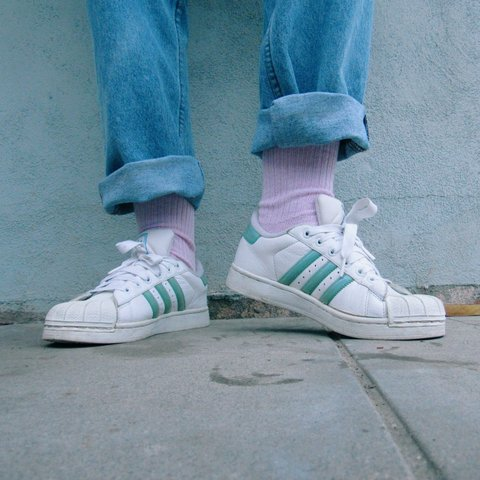 712f59ff97a5 @hibachishrimp. 3 years ago. California, USA. Light blue iridescent-like Adidas  Superstars!