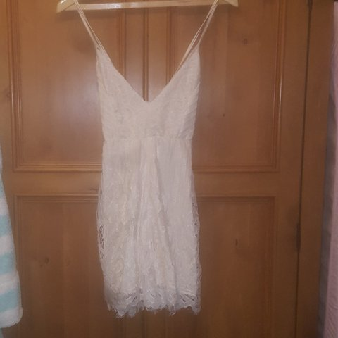 bab6c9c4e5 White cream lace playsuit with cross over silk straps. Never - Depop
