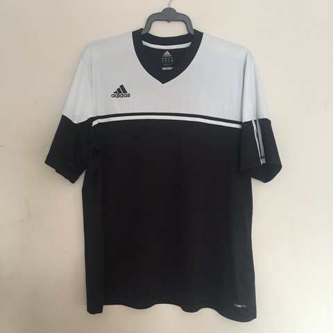 504d5dec025d Black and white Adidas Climalite top in a size 2XL. It's but - Depop