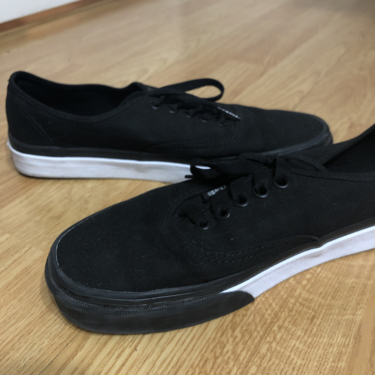 BLACK VANS with a black and white sole