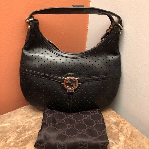 c5899371db5f61 This is an authentic GUCCI Perforated Leather Reins Hobo is - Depop