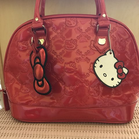 9a064216c @asglamasiam. 7 months ago. Chicago, United States. Cherry red Loungefly & Hello  Kitty large handbag. Embossed patent leather material.
