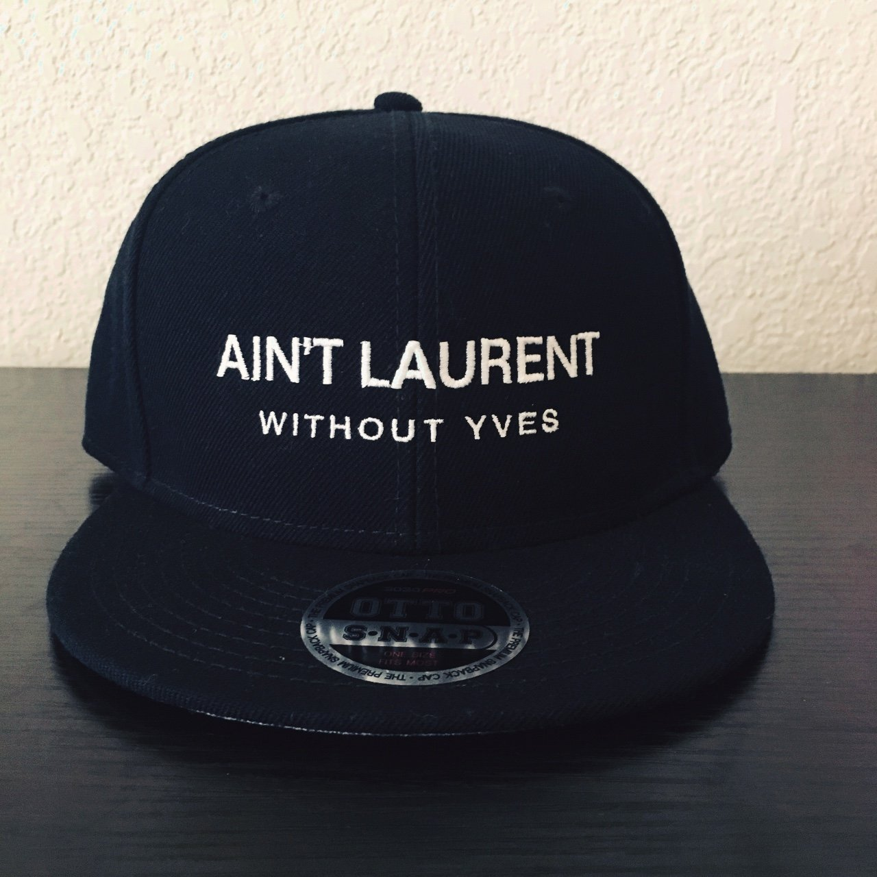 cc6b9318 Ain't Laurent Without Yves SnapBack Hat in Black - Sizing - - Depop