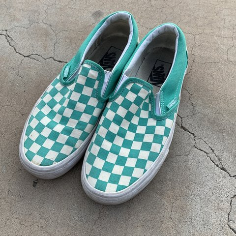 Teal colored checkered slip on vans