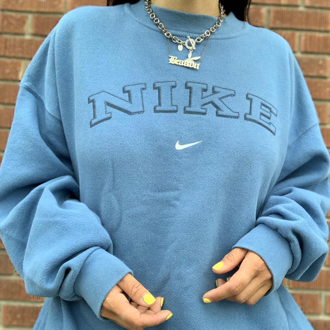 vintage 90s Nike crewneck sweater with spellout and Depop