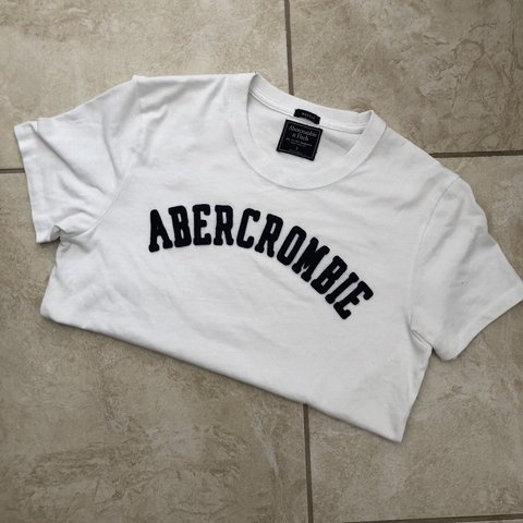 5e46d9778b @_sambarber. last year. Ipswich, United Kingdom. Abercrombie & Fitch T-Shirt  In White Size: Small