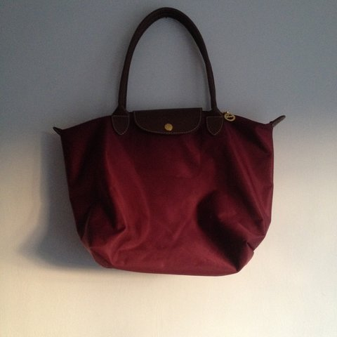 0d79756874 @rioandhank. 3 years ago. Chertsey, United Kingdom. A genuine Longchamp Le  Pliage bag. Maroon colour with tan ...