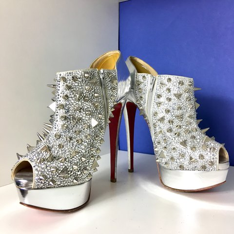 010669a47fff Christian Louboutin Bridget Back spiked ankle boots silver - Depop