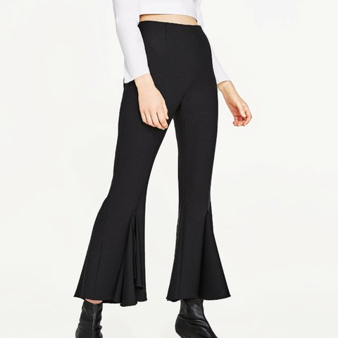 c247d82a @hafsa_. last year. United Kingdom. Zara frilly crepe flared trousers.  Extremely flattering. Black. Size XS.