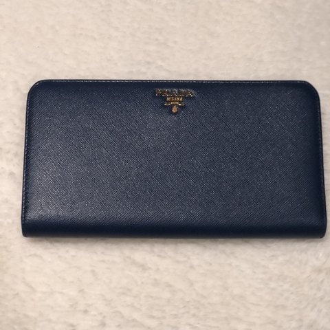 78a052b2b0daec @avinashrambojun. 4 months ago. Woodford Green, United Kingdom. Prada Blue Saffiano  leather wallet. Comes with box and authenticity card.