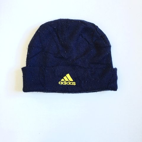 57283ca93a9f6 Navy beanie hat with yellow Adidas logo Postage will be If - Depop