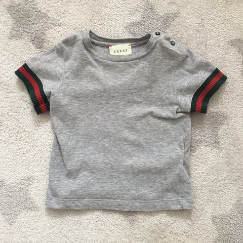 c381e254 @romyrodmell. last year. Liverpool, United Kingdom. Genuine baby boy Gucci  tshirt.