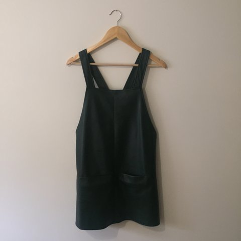 d424266b5bf4 Bottle green faux leather pinafore dress with two pockets at - Depop