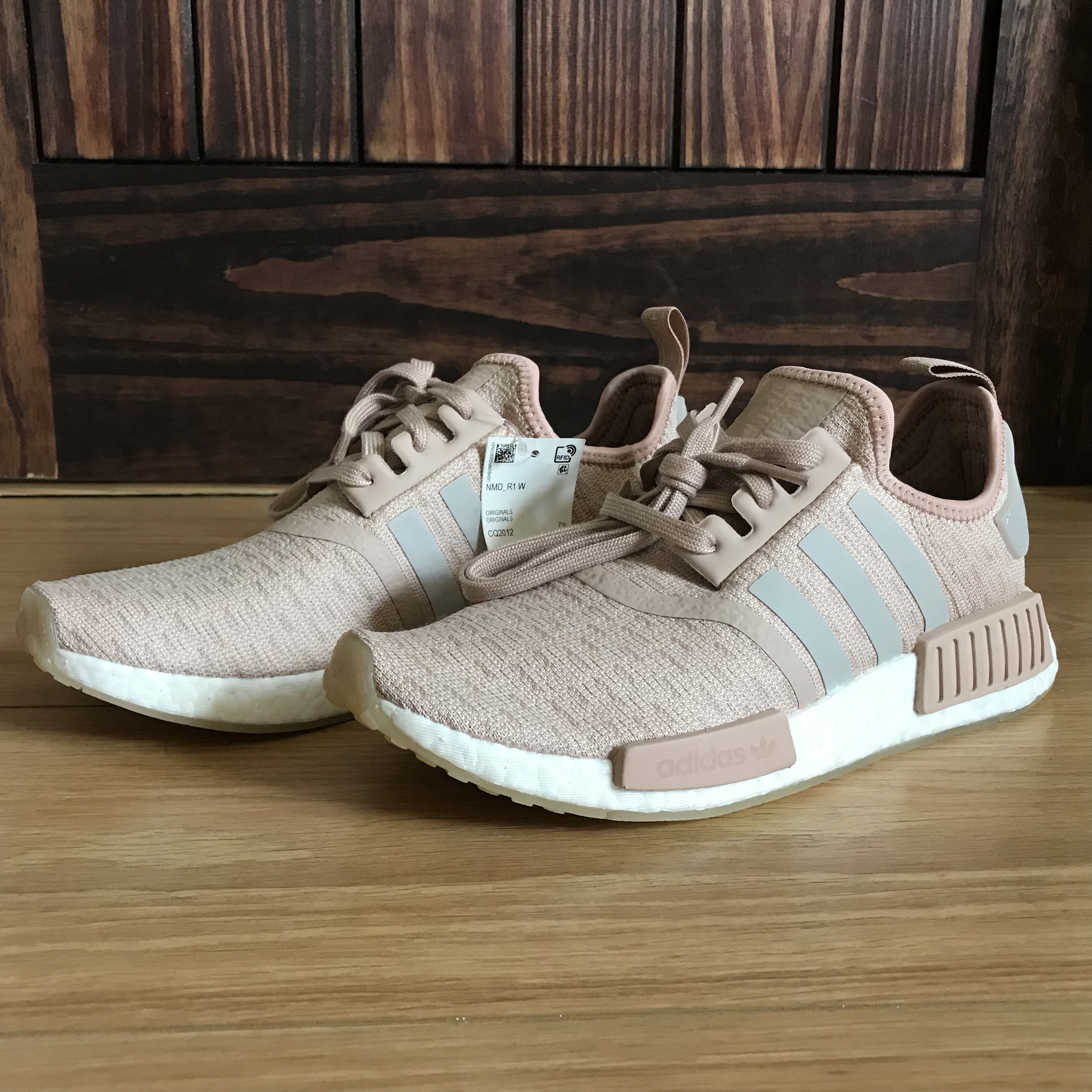 new women's adidas nmd r1 in the color ash pearl. Depop