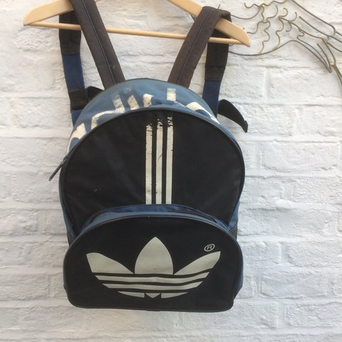 12f5365498 @hazeloguz. 2 years ago. Watford, United Kingdom. Vintage Adidas rucksack  backpack bag. Retro 90s sportswear.