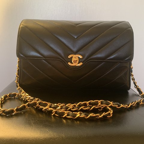 28baa7f3cb87 @judychow24. 11 days ago. San Francisco, United States. Authentic Chanel  chevron flap. Here I have a vintage chevron flap in black lambskin with 24k  gold ...