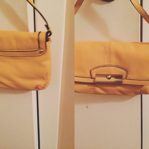 d4d93ed617 Small yellow leather coach purse *there is a red on the back - Depop