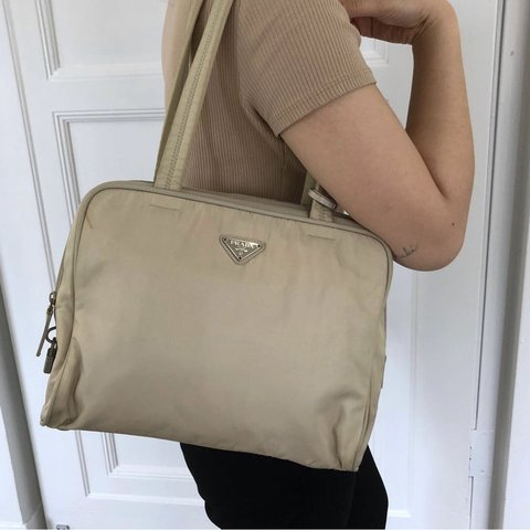 15766992e0 @kateemao. 21 days ago. Toronto, Canada. Authentic Prada Nylon Cream Bag.