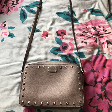 401879d38ce6 Small Michael Kors cross body bag in silver grey. Been used - Depop