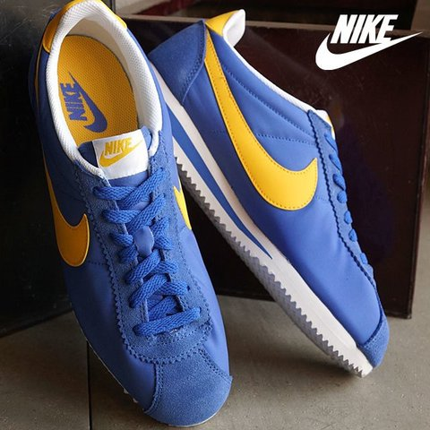 low priced 5d504 41cd9  aleksrose. last year. London, United Kingdom. Worn once 10 10 condition  blue and yellow nylon Nike Cortez.