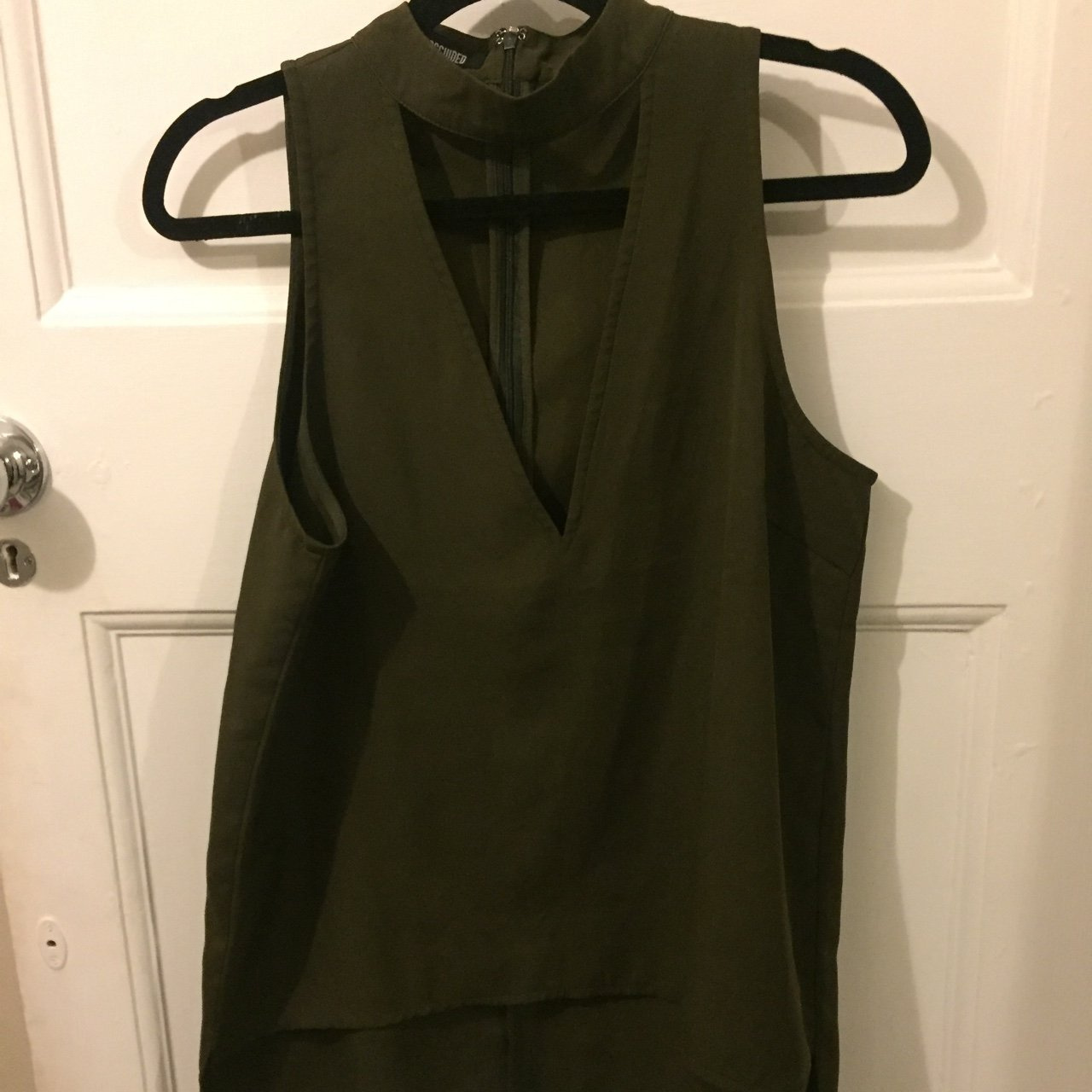 dd522de76896 @mhenson1. 3 years ago. London, UK. Missguided plunge top in khaki, never  been worn!