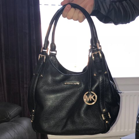 7eba2d5ffaeb8e Black Michael Kors bag with gold sign and zip etc. In bought - Depop
