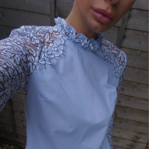 9827d02012e772 @makeupfairypro. 2 years ago. London, UK. Stunning baby blue high neck shirt  with lace detail ...