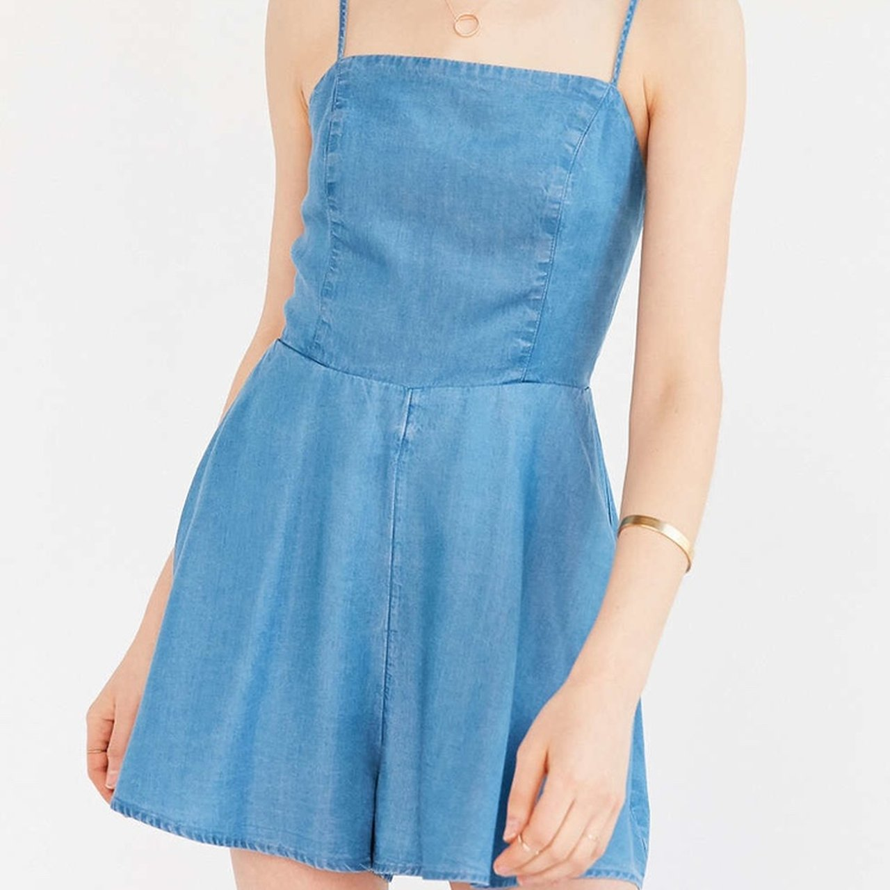 822aa922928 Denim colored flowy romper from Urban Outfitters. Zipper the - Depop